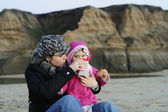 Beach snack - mommy, daughter and milk — Stock Photo
