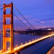 Stock Photo: Glowing Golden Gate Bridge at dusk
