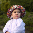 Infant girl on a cold summer evening — Stock Photo