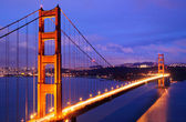 Glowing Golden Gate Bridge at dusk — Stock Photo