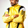 Young serious man in a yellow sports jacket — Stock Photo