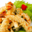 Tiger prawns in tempura with lettuce leaves — Stock Photo
