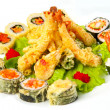 Tiger prawns in tempura and hot rolls with lettuce leaves — Stock Photo