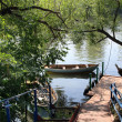 Pier on a small river — Stock Photo