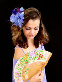 The girl with a fan — Stock Photo