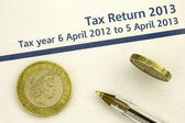 Tax return 2013 form and money — Stock Photo