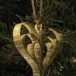 Hand made paper heart shape christmas toy on the tree — Stock Photo