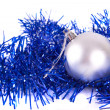 Silver christmas ball with tinsel — Stock Photo