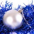 White christmas ball with tinsel — Stock Photo