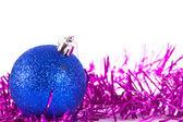 Blue christmas ball with tinsel — Stock Photo