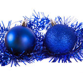 Blue christmas ball with tinsel — Stock Photo