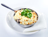 Mushroom gratin with eggs and cheese — Stock Photo