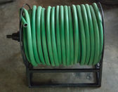 Watering garden hose on the spool — Stock Photo