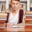Confident young man writing something — Stock Photo