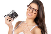 Woman in lingerie holding camera and gesturing — Stock Photo