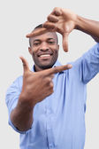 African man focusing on you and smiling — Stock Photo