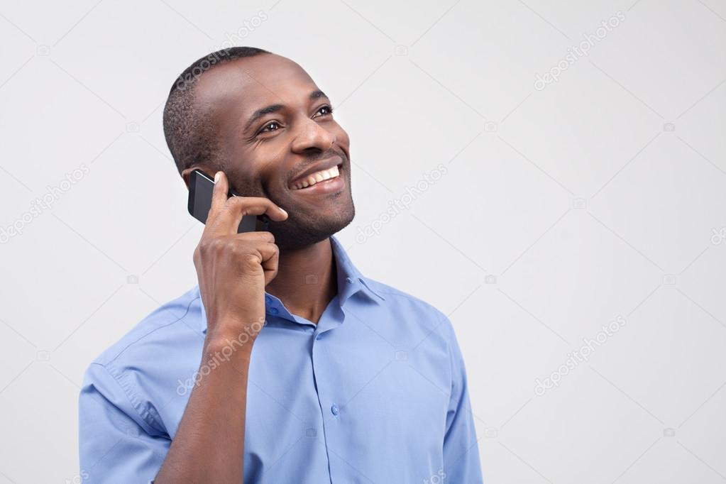Black Man on Phone Cheerful Black Man Talking on