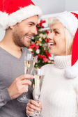 Couple holding champagne flutes and looking at each other — Стоковое фото