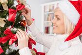 Woman decorating a Christmas — Stock Photo
