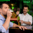 Drinking freshly tapped beer — Stock Photo #37123763