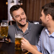 Relaxing in beer pub — Stock Photo