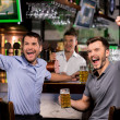 Watching TV in bar — Stock Photo