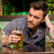 Lonely man in bar — Stock Photo #37123917