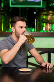 Drinking fresh beer — Stock Photo