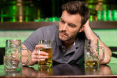 Lonely man in bar — Stock Photo