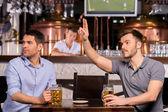 Men sitting in bar — Stock Photo