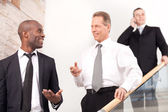 Business people on staircase — Stock Photo