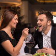 Couple feeding each other — Stock Photo