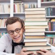 Stock Photo: Young min library and hugging book stack