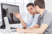 Two confident young men discussing something — Stock Photo
