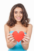 Young woman holding a red paper heart — Stock Photo