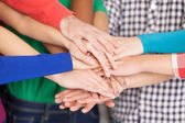 Many hands clasped together — Stock Photo