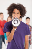 Young African teenager shouting at megaphone — Stock Photo