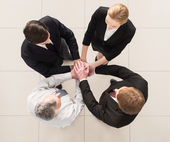 Top view of four people in formalwear — Stock Photo