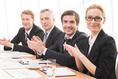 Four people in formalwear applauding you — Stock Photo
