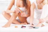 Beautiful young women doing pedicure — 图库照片