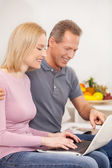 Couple using laptop together — Stock Photo
