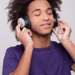 Cheerful African teenager in headphones — Stock Photo #39310599