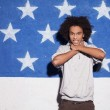Young and carefree. Young African man posing against American flag — Stock Photo #39310795