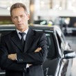 Stock Photo: Min formalwear standing in front of car
