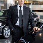 Businessman choosing a new car — Stock Photo #39318721