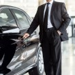 Businessman standing near car — Stock Photo