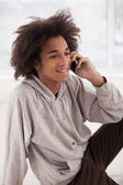 African teenager talking on the mobile phone — Stock Photo