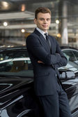 Man in formalwear leaning at the car — Stock Photo