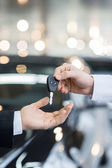 Man giving key to the car owner — Stock Photo