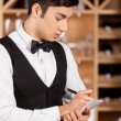 Waiter making notes. — Stock Photo